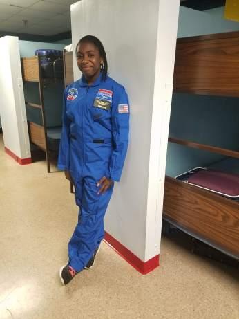 Simone looking snazzy in her astronaut uniform!
